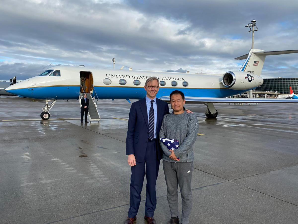 This photo provided by the U.S. State Department, U.S. special representative for Iran, Brian Hook stands with Xiyue Wang in Zurich, Switzerland on Saturday.