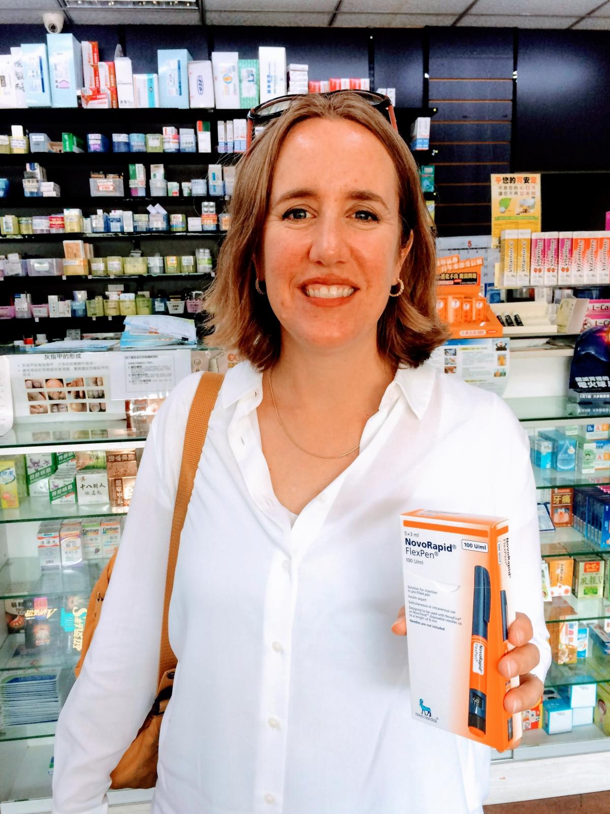 Lija Greenseid, a consultant with a nonprofit in St. Paul, Minn., paid $40 at this Taiwanese pharmacy for a box of insulin pens. It's the same medicine that she has paid $700 for in the United States. Greenseid's daughter, who has Type 1 diabetes, goes th