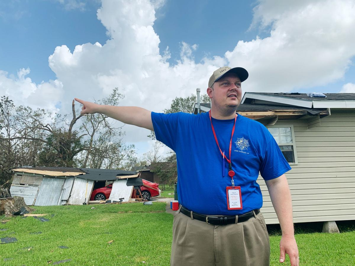 Lake Charles Mayor Nic Hunter visits a neighborhood damaged by Hurricane Laura. Tens of thousands of people will be without electricity for weeks, according to the local utility company.