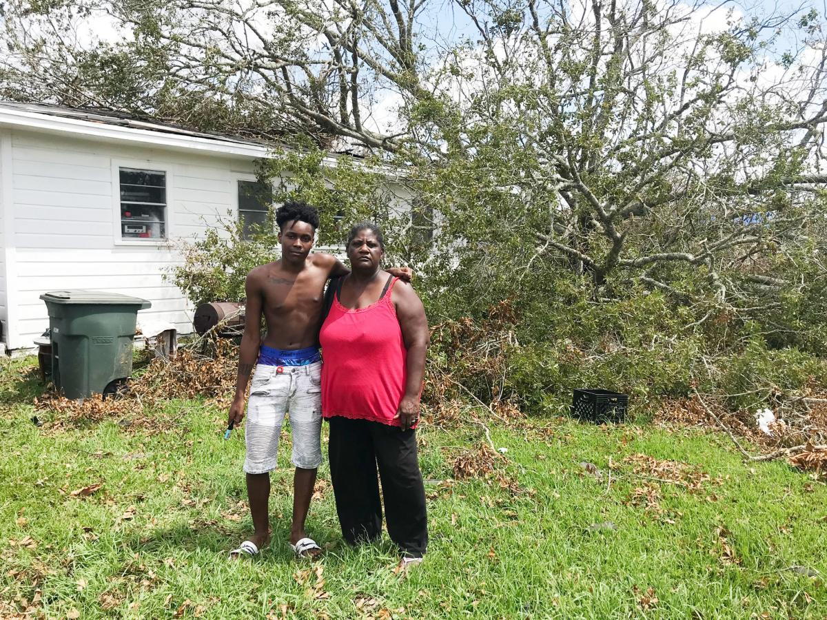Qwentin Smith and grandmother Gwendolyn Smith stand in front of their home in Lake Charles. Two trees crushed the back of the house when Laura ripped through southwest Louisiana.