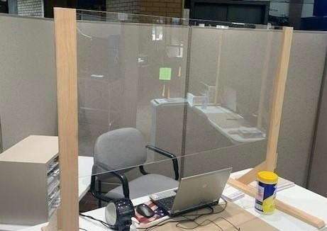An improvised divider aims to protect voters and poll workers from the coronavirus.
