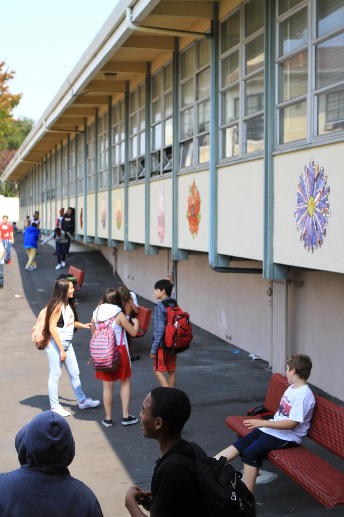 Students congregate outside at Edna Brewer Middle School. The hope of restorative justice is that dialogue builds trust and community and reduces the need for suspensions and expulsions.