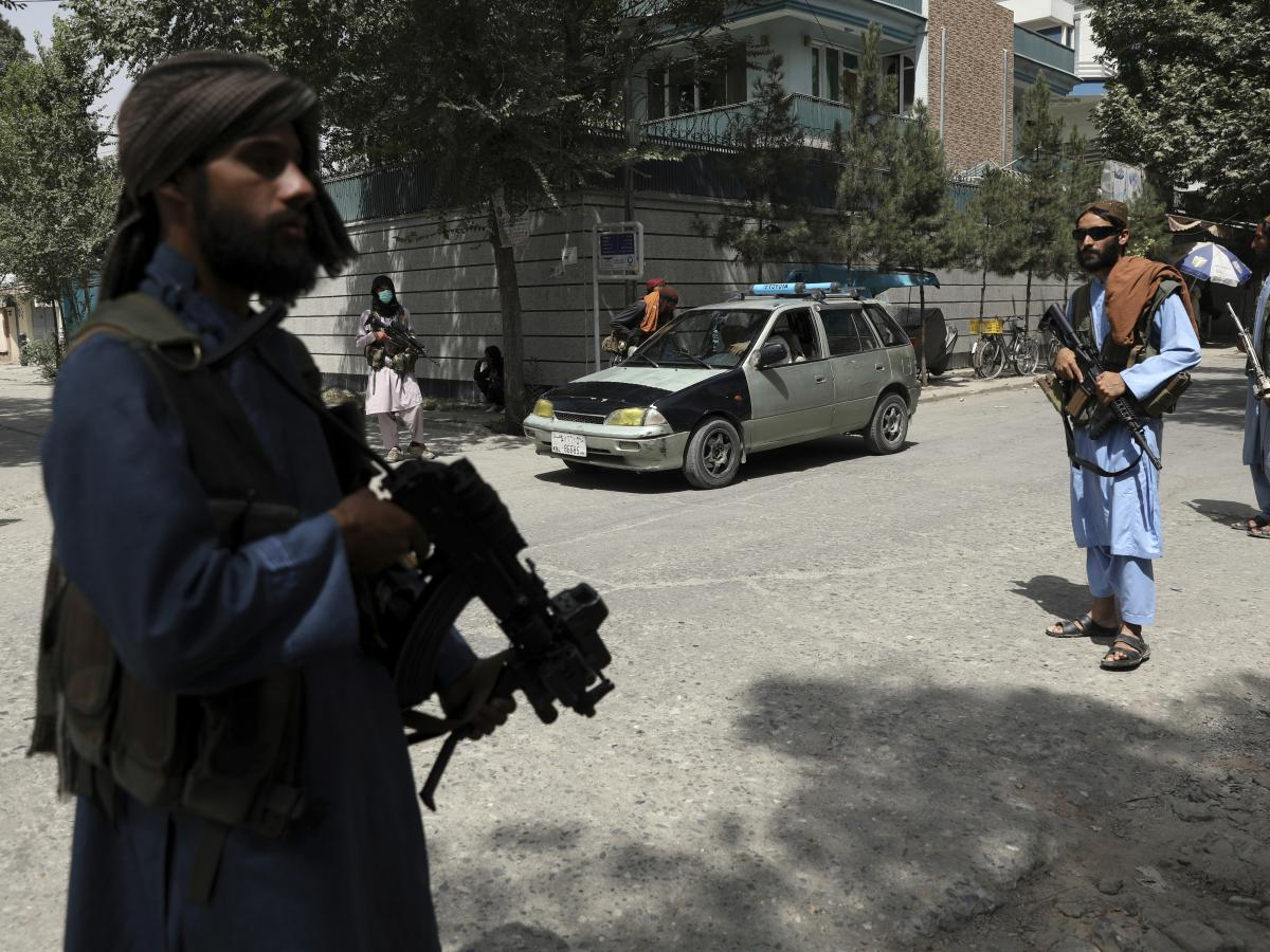 Taliban fighters stand guard at a checkpoint in the Wazir Akbar Khan neighborhood in Kabul, Afghanistan, on Wednesday.