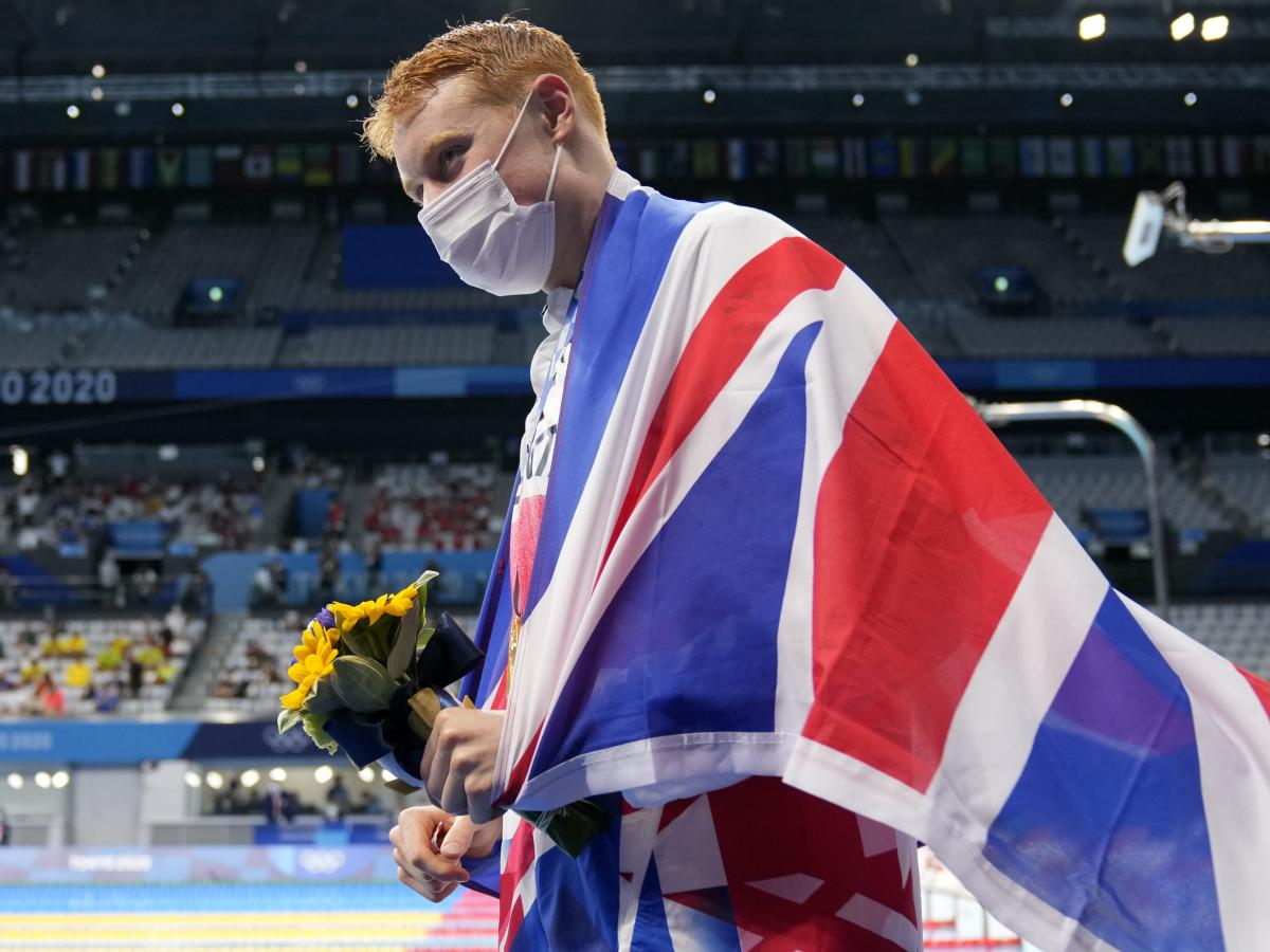 Tom Dean of Britain celebrates after winning the men's 200-meter freestyle at the Tokyo Olympics on Tuesday.