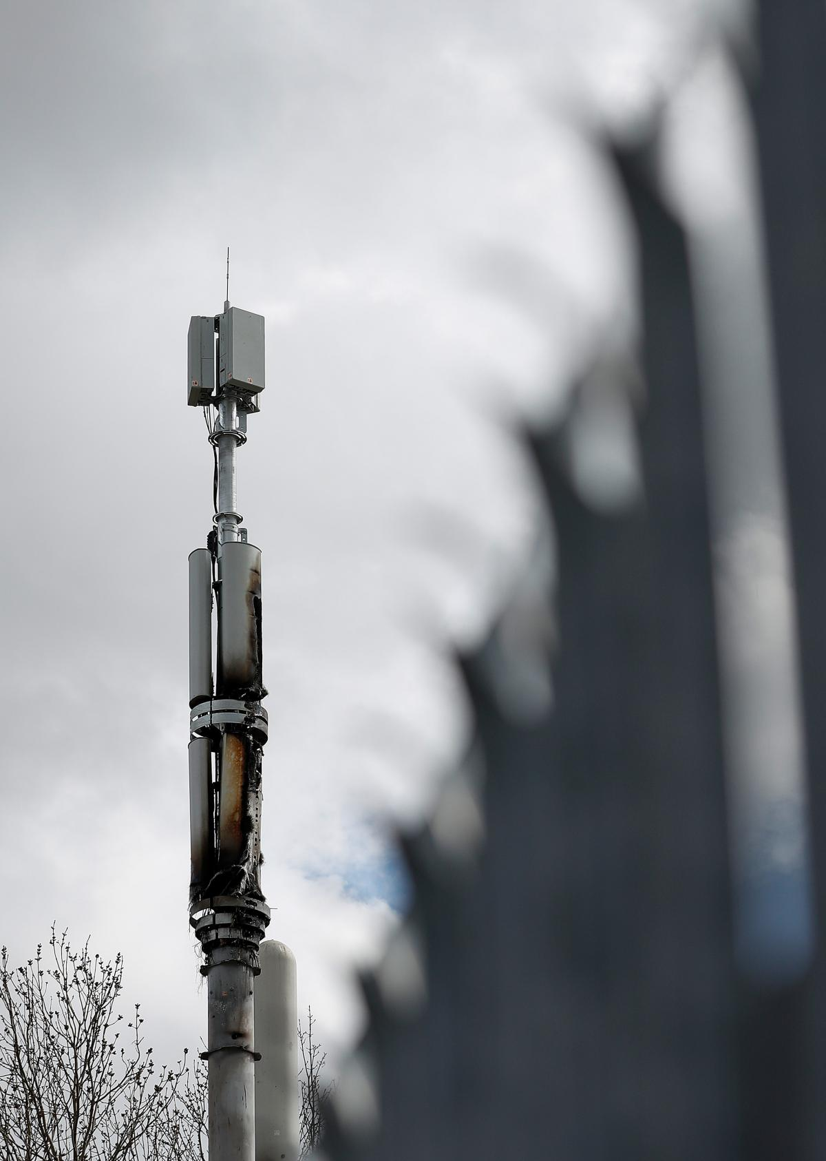 A fire-damaged telecom tower stands in Birmingham, England, in April. Authorities have cited conspiracy theories about 5G and the coronavirus as a possible motivation for a rash of such fires in the U.K.