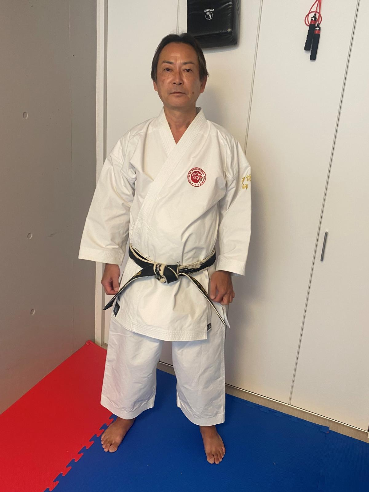 """Kenshin Iwata poses inside his dojo in Tokyo. He says in karate, the body is a weapon. """"It's what we call the art of killing with one blow,"""" he says."""