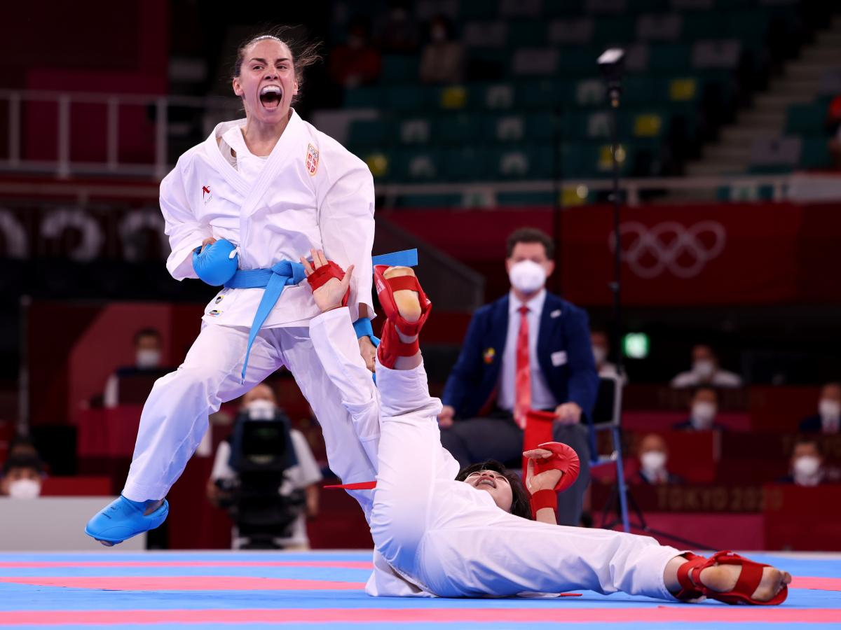 Jovana Prekovic (L) of Team Serbia competes against Yin Xiaoyan of Team China during the Women's Karate Kumite -61kg Gold Medal Bout on Friday at the Tokyo 2020 Olympics.