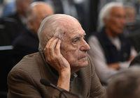 Former general and member of the military junta, Reynaldo Bignone, gestures during his trial to investigate the crimes committed during the Operation Condor in March 2013.