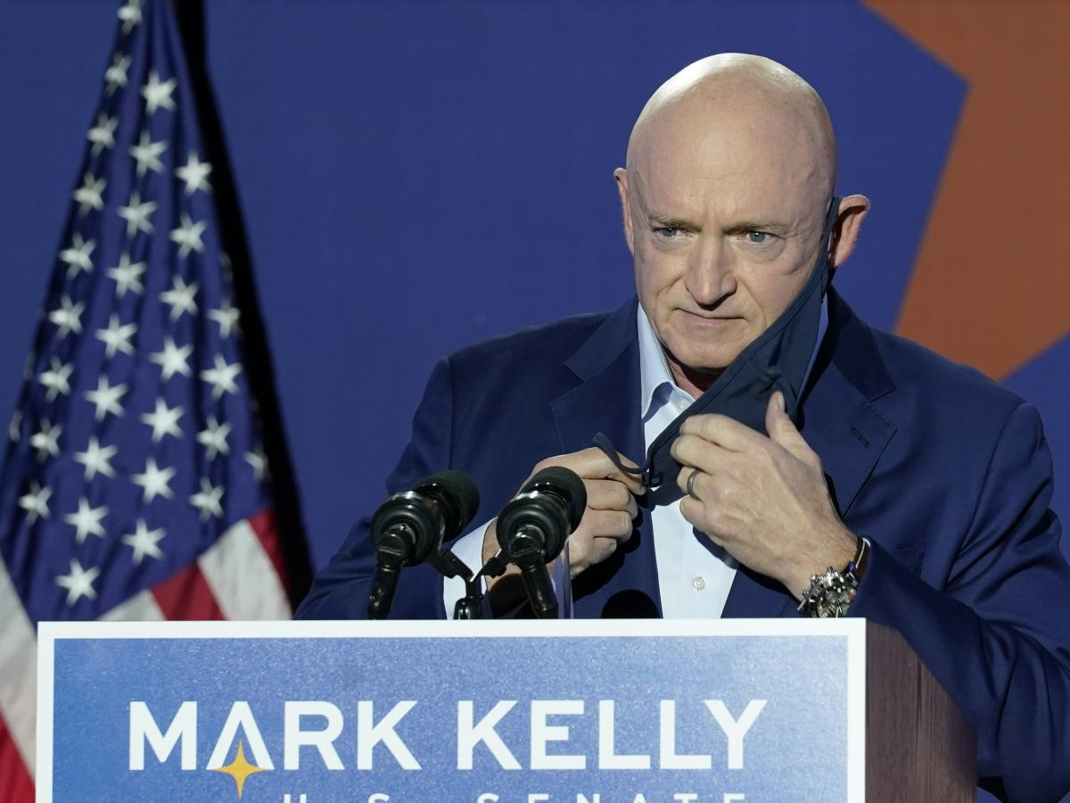 Sen.-elect Mark Kelly prepares to speak at an election night event in Tucson, Ariz. Kelly is set to be sworn in on Wednesday.