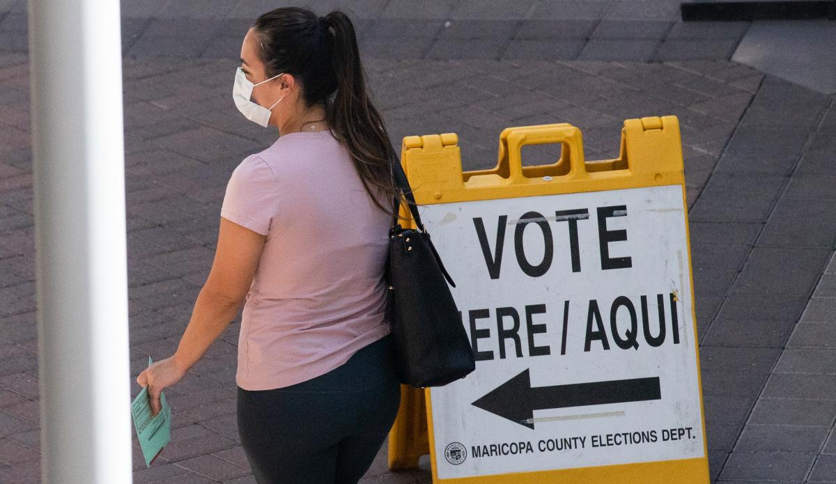 A voter waits to cast their ballot during Arizona's primary election on Aug. 4 in Phoenix.