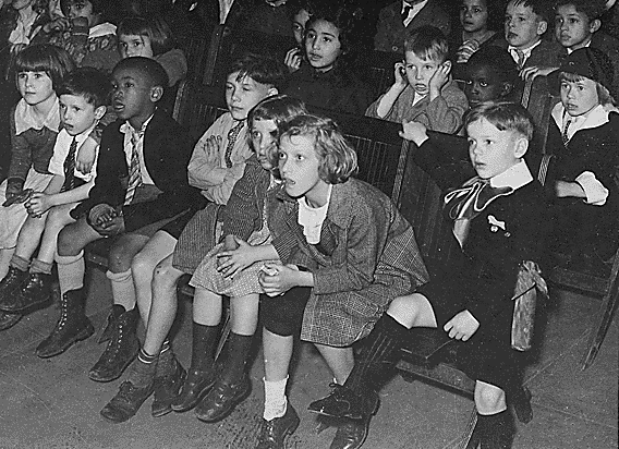 New York City children attend a show by the Marionette Unit of the WPA's Federal Theatre Project puppet show in 1935.