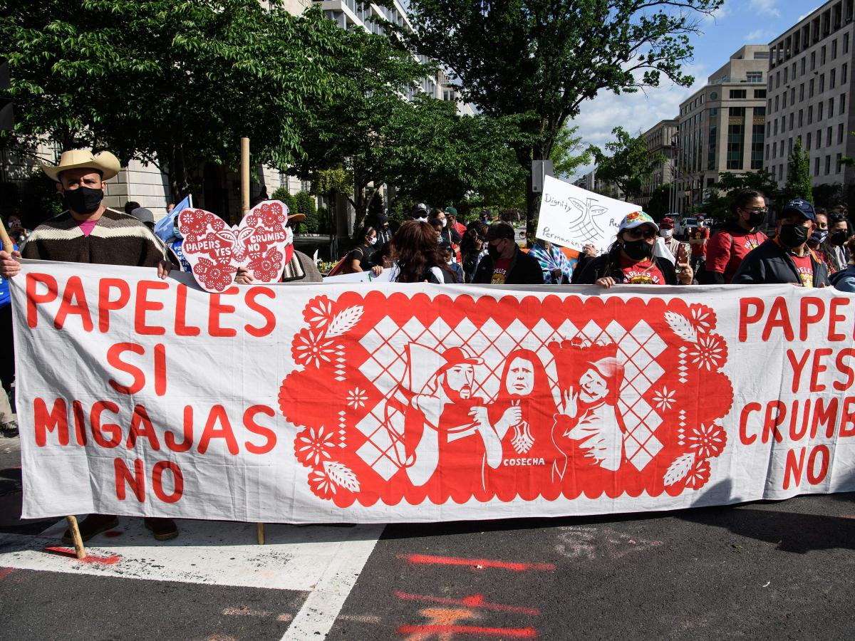 Immigration activists march near the White House on April 30 to demand more immigration action from President Biden.