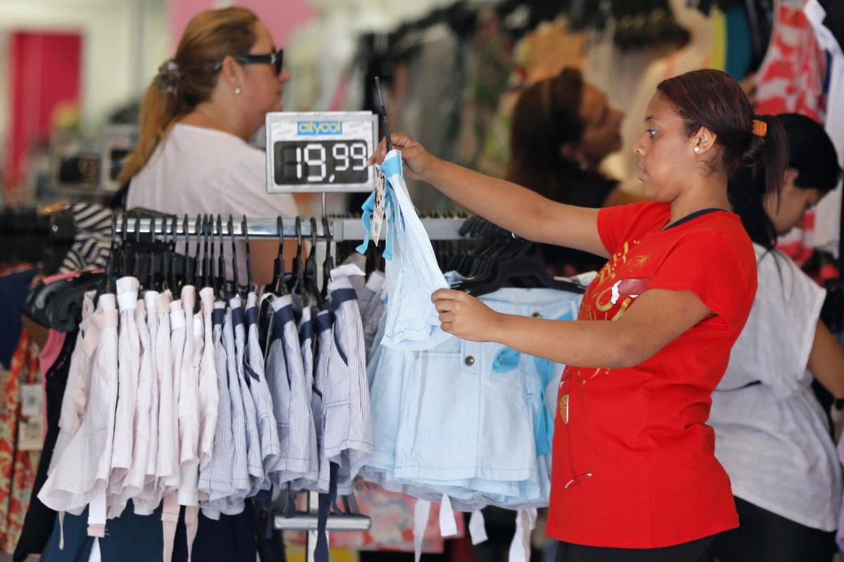 A woman looks at clothes inside a shop in Rio de Janeiro. Consumption has been a huge driver of the Brazilian economy, but the boom years are over, and economists say the outlook isn't good.
