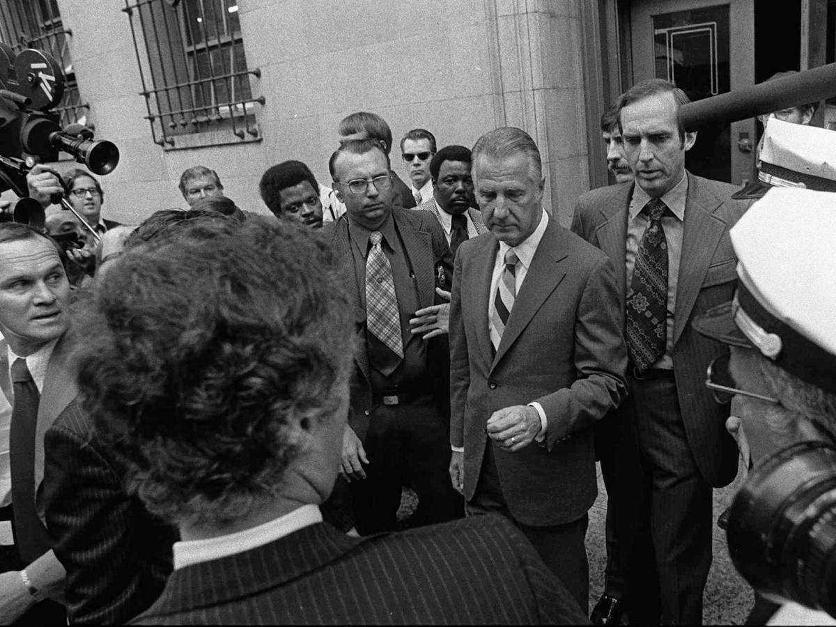 Spiro T. Agnew (center) pleaded no contest to a charge of income tax evasion — after attacks against the judicial system. Agnew resigned from the vice presidency.