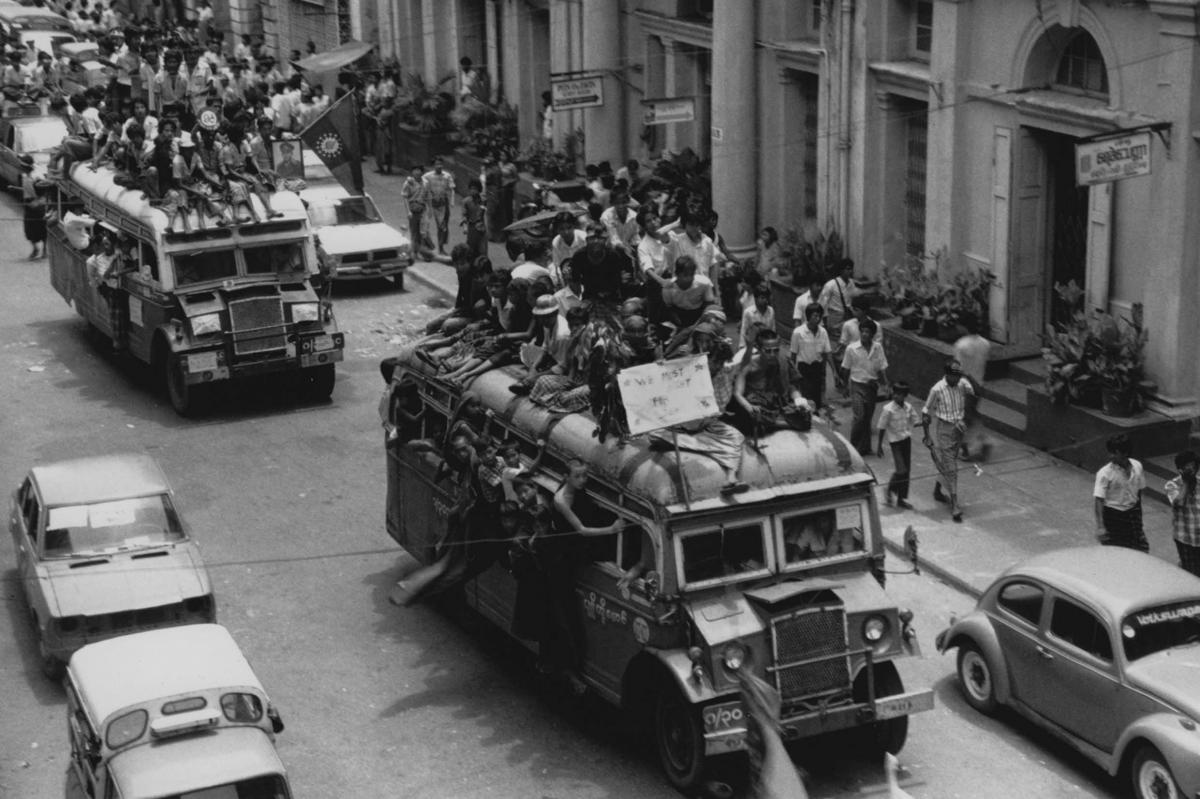 """Demonstrators piled on buses in downtown Rangoon. """"The Buddhist monks, the housewives union — they were all joining in the street,"""" recalls student activist Khin Ohmar."""