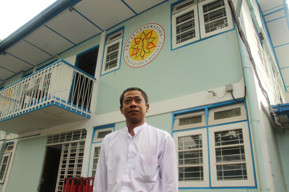 """Htay Kywe, a student leader of the protests in 1988, stands outside the 88 Generation Students Group offices in Yangon this year. When the protests began, he says, """"we students had no hopes for any jobs after school. We were totally lost."""""""