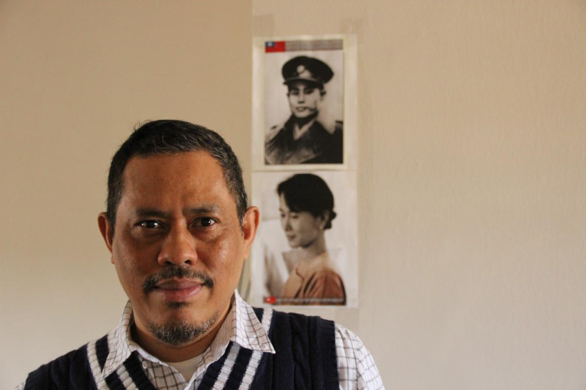Moethee Zun, a 1988 student leader, at his apartment in Queens, N.Y., earlier this year. Pictures of Aung San Suu Kyi and her father, Aung San, are on the wall behind him. Once the crackdown began in September 1988, thousands of activists fled the country