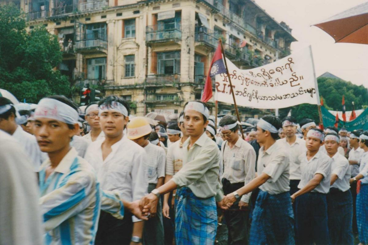 Demonstrators march through Rangoon. A banner identifies them as students from Rangoon Institute of Technology, where the first demonstrations broke out in March 1988.