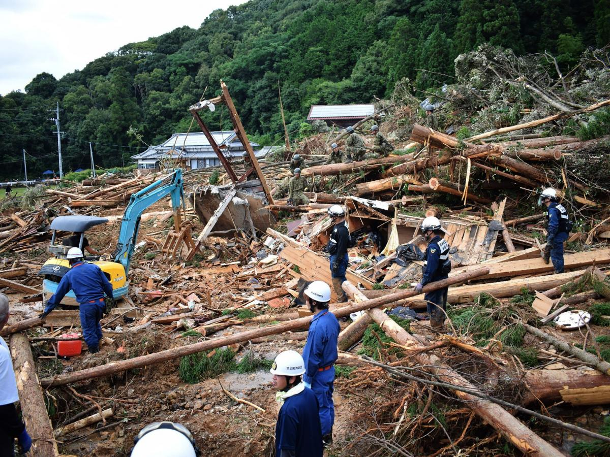 Members of Japan's Self-Defence Forces work at the site of a landslide caused by heavy rain in Ashikita, Kumamoto prefecture.