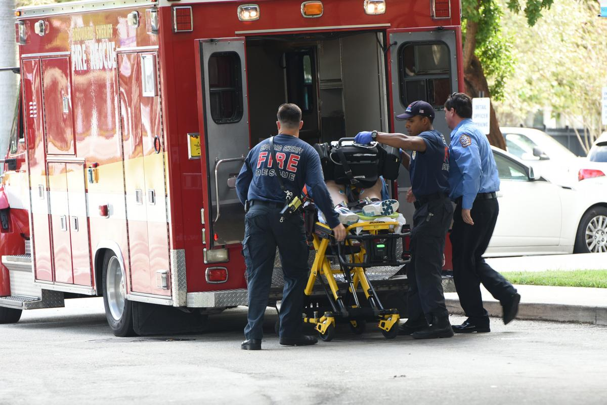 A victim is taken into Broward Health Trauma Center in Fort Lauderdale, Fla., on Friday following a shooting at the Fort Lauderdale-Hollywood International Airport.
