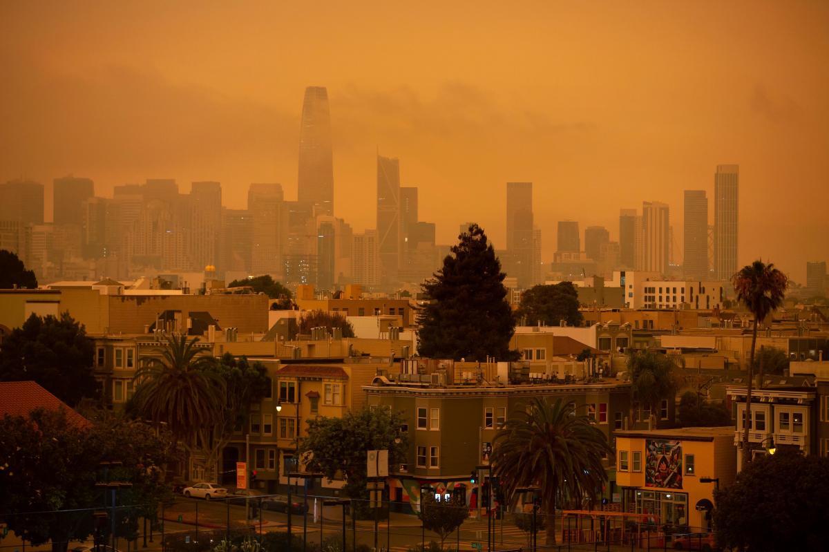 A smoky haze blanketed San Francisco on Wednesday. California has already seen more than 2.5 million acres burn this year.