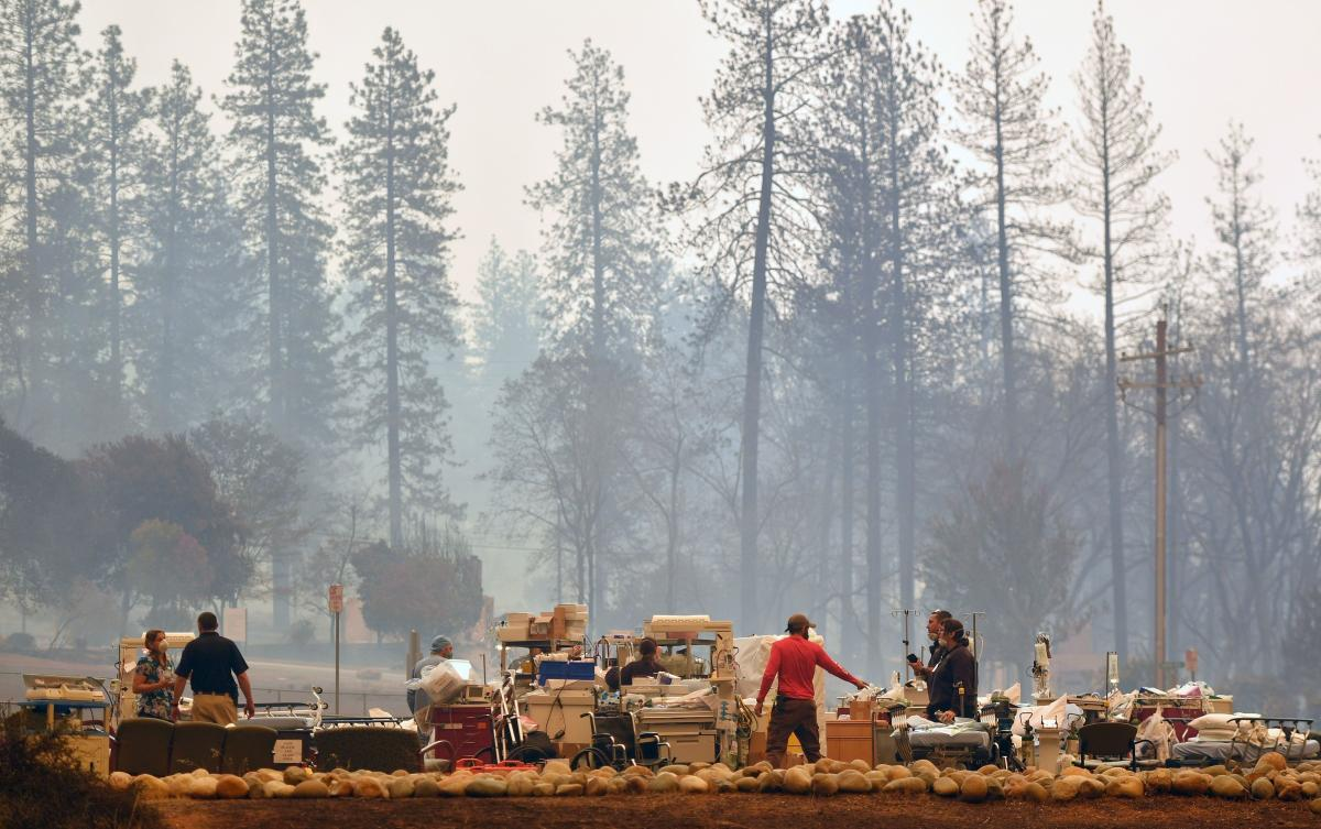 Search and rescue teams scramble to get patients and medical devices to safety as the Camp Fire cuts a fiery path through Paradise.