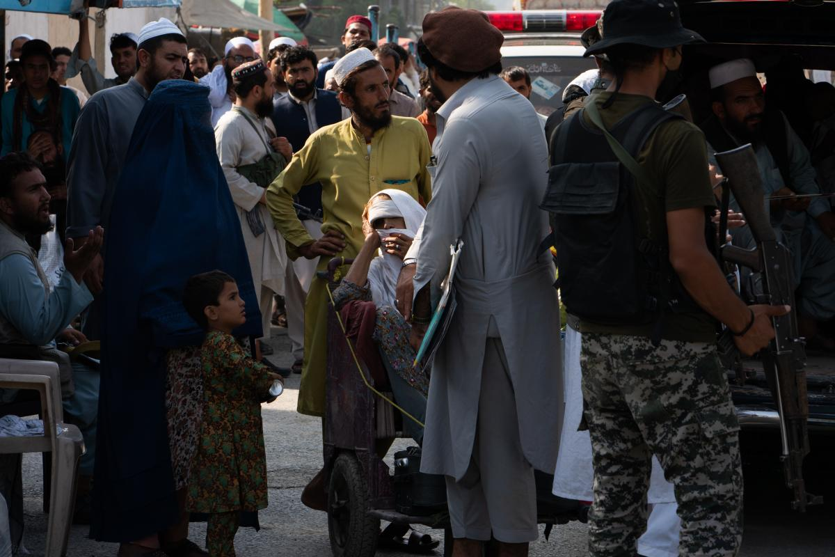People seeking medical attention wait on the border to enter Pakistan.