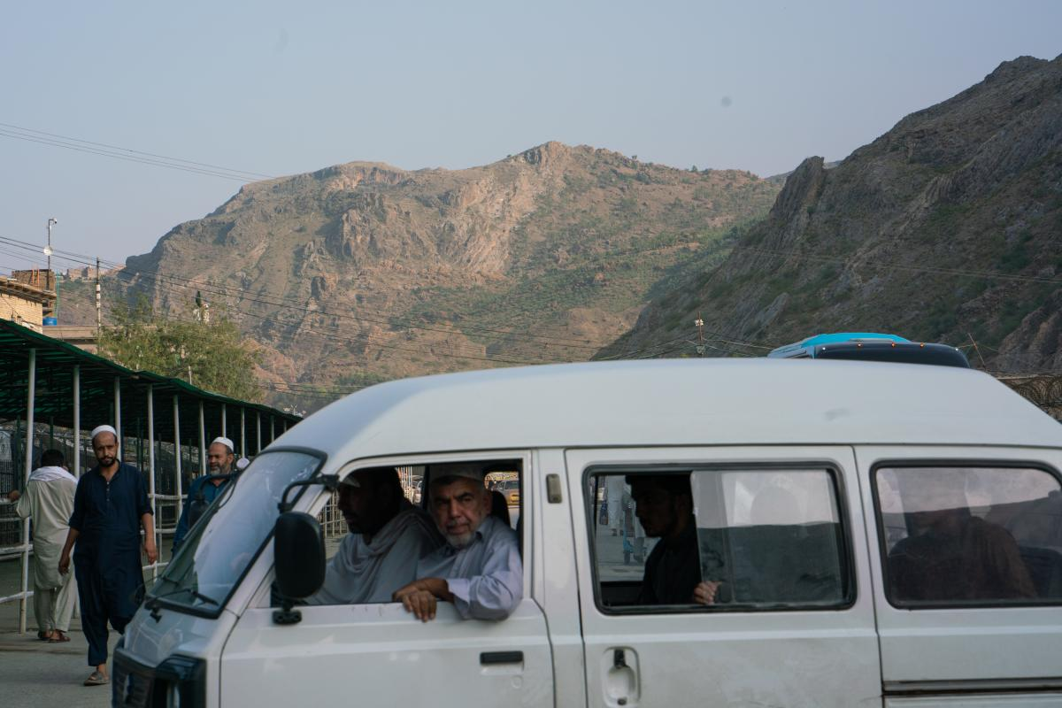 A Pakistani minibus arrives to transport people to and from the border.