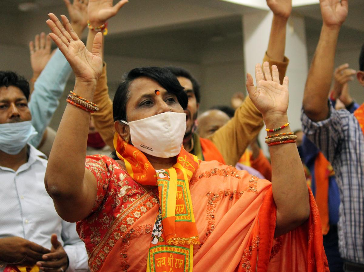 People in New Delhi on Wednesday watch a live telecast of Modi's participation in a bhoomi pujan, or groundbreaking ceremony, to mark the building of a Hindu temple in Ayodhya.
