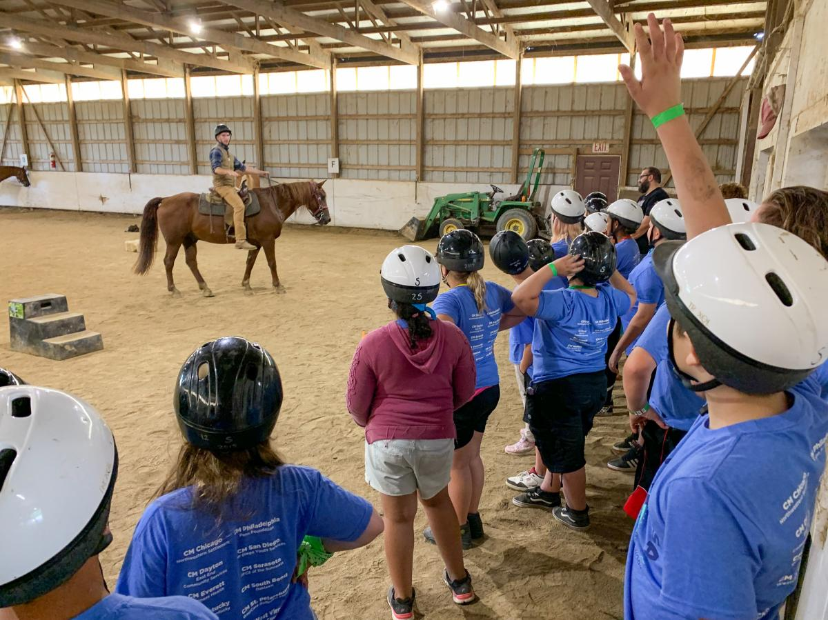 "Children at Camp Mariposa are encouraged to take ""healthy risks,"" such as ziplining, rock climbing and horseback riding. They learn to overcome their fears with their camp mentors close by. One child says, ""The last time I got on, I was freaking out and c"