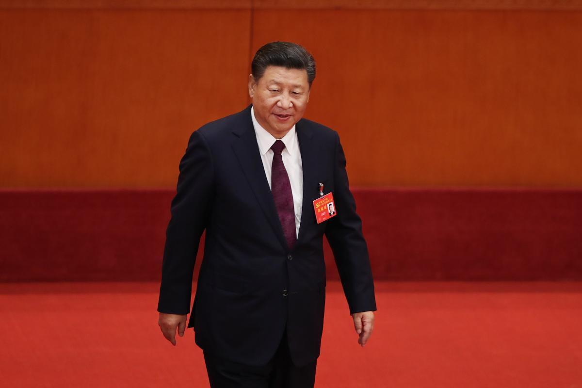 "Chinese President Xi Jinping, shown here during the opening session of the 19th Communist Party Congress in Beijing, ""is running China in crisis mode,"" says New Zealand academic Anne-Marie Brady, ""and China under Xi is following a very ambitious, a very a"