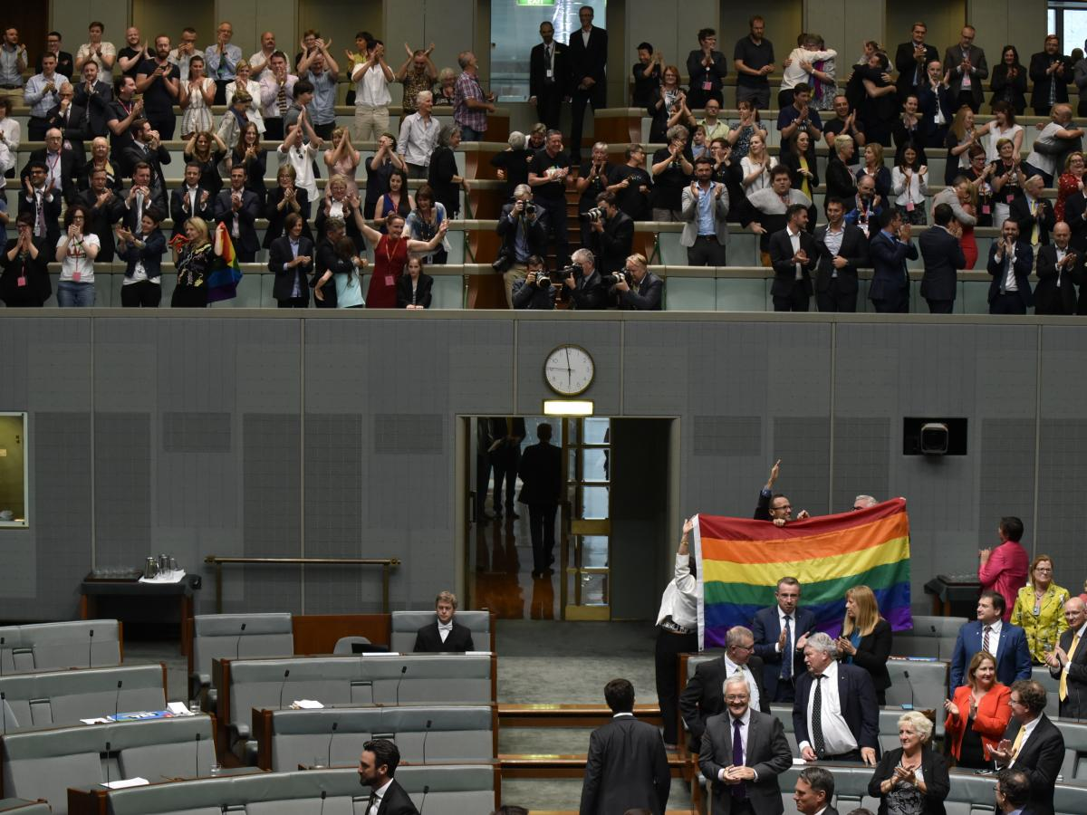 Members of Parliament celebrate at Parliament House on Thursday in Canberra, Australia, after the approval of same-sex marriage.