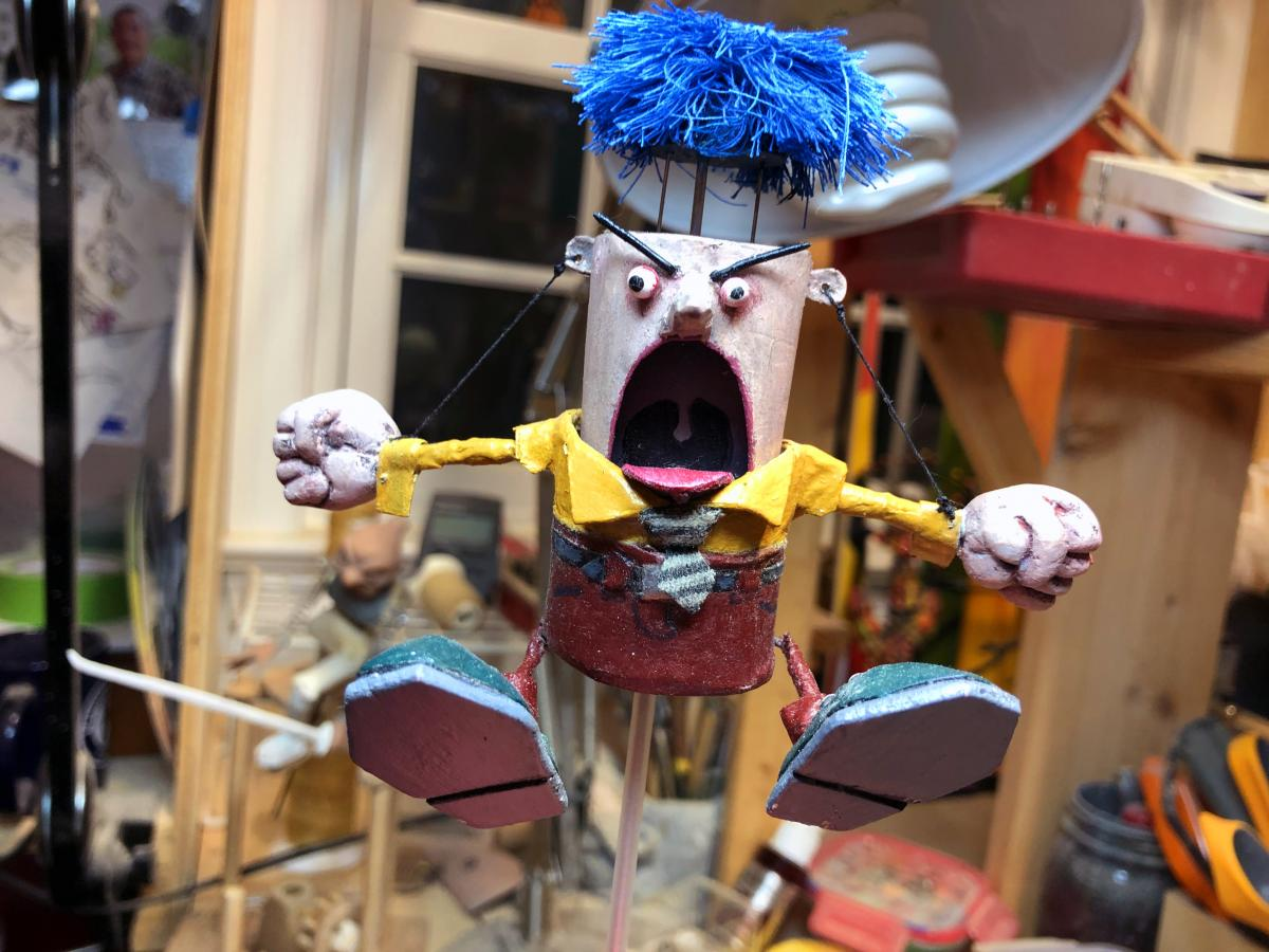 """Don Becker's """"Angry Man"""" automaton slowly rises, shakes his fists and blows his wig off when you turn a crank."""