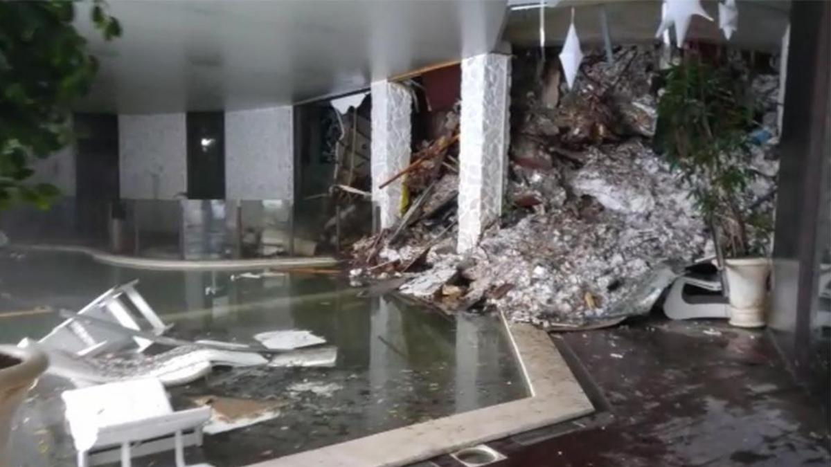 A screenshot from a video shows piles of snow and rubble cascading down the stairway into the foyer of the Hotel Rigopiano on early Thursday.