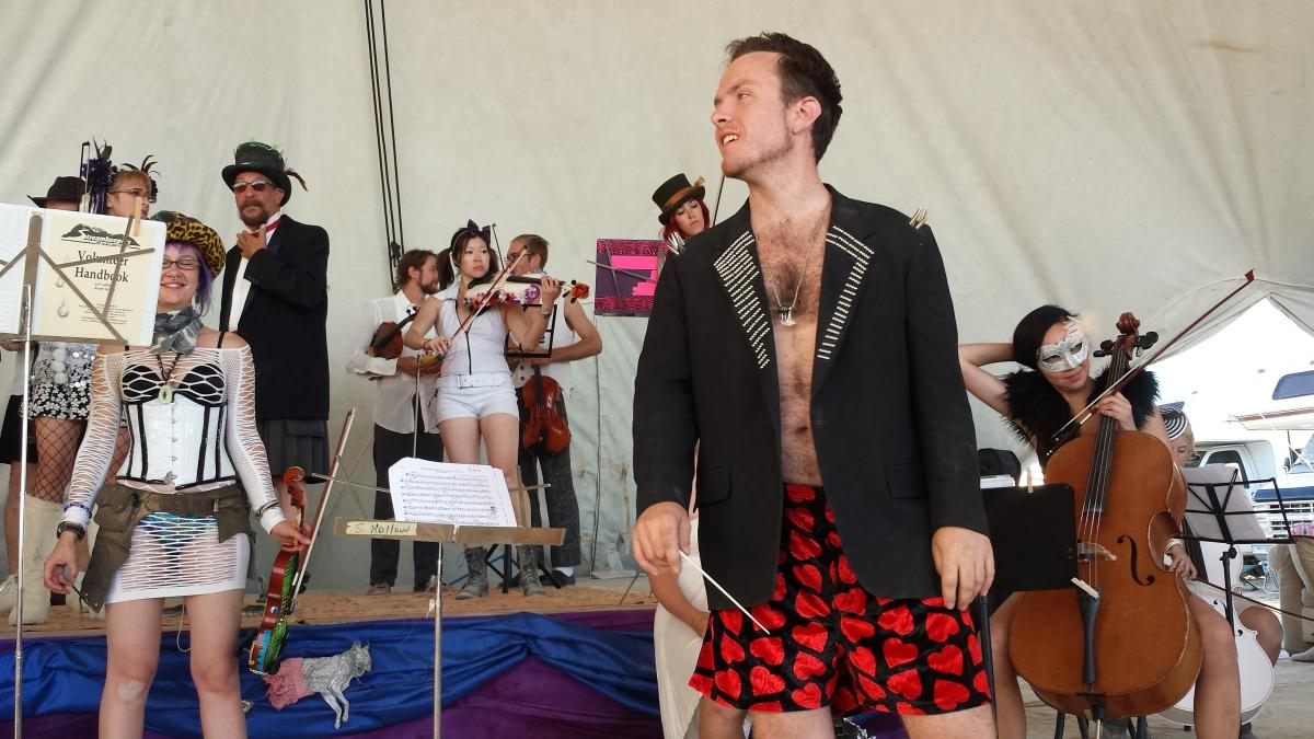 Dr. FireTuba (Eric Yttri) conducted the first-ever string orchestra at Burning Man in 2014.