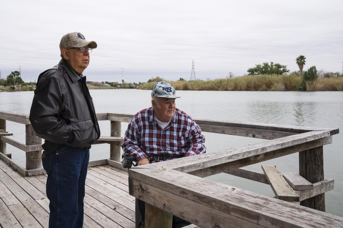 Cousins Rey Anzaldua (left) and Cavazos own a rustic campground in Mission. The government wants to put the wall and a wide patrol zone along the north end of their property. They worry it will drive away his tenants, who may not want to be walled off fro