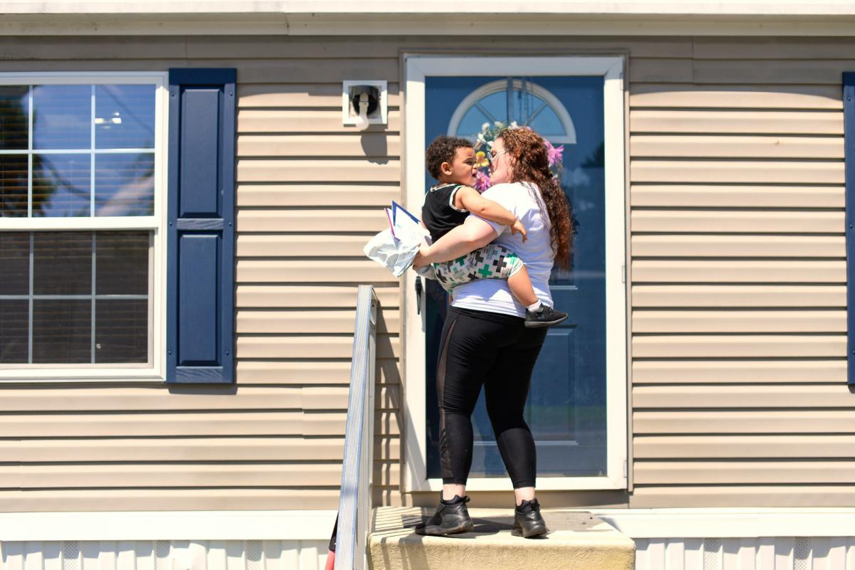 Kelly Zimmerman holds her son, Jaxton, outside their home in Douglassville, Pa. Kelly moved in with her parents before Jaxton's birth; the baby's father died in July of 2016 from a heart attack.