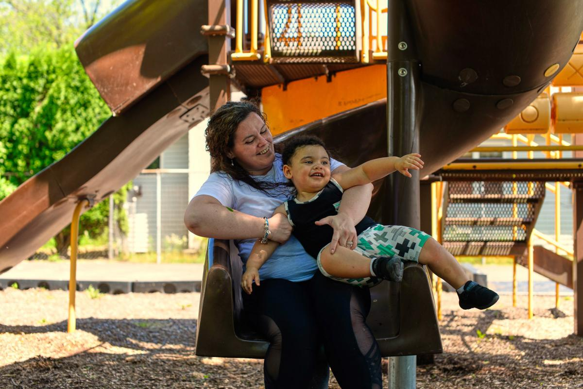 """Mother and son take a play break near their home in Douglassville, Pa. """"I'm really lucky, Kelly Zimmerman says, because my family has made a lot of adjustments — a lot of changes to help me get back on my feet."""""""