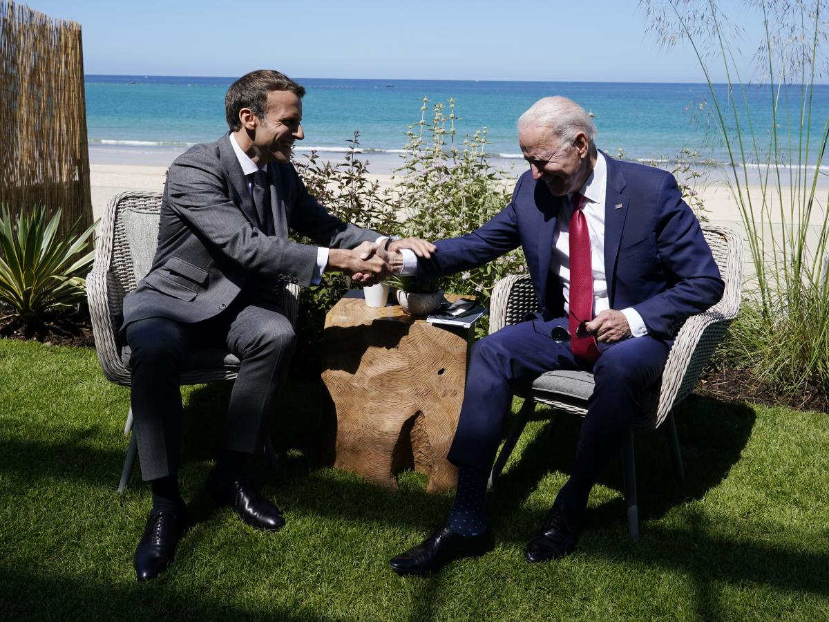 """President Biden and French President Emmanuel Macron met on the sidelines. """"I think it's great to have the U.S. president part of the club and very willing to cooperate,"""" Macron said."""