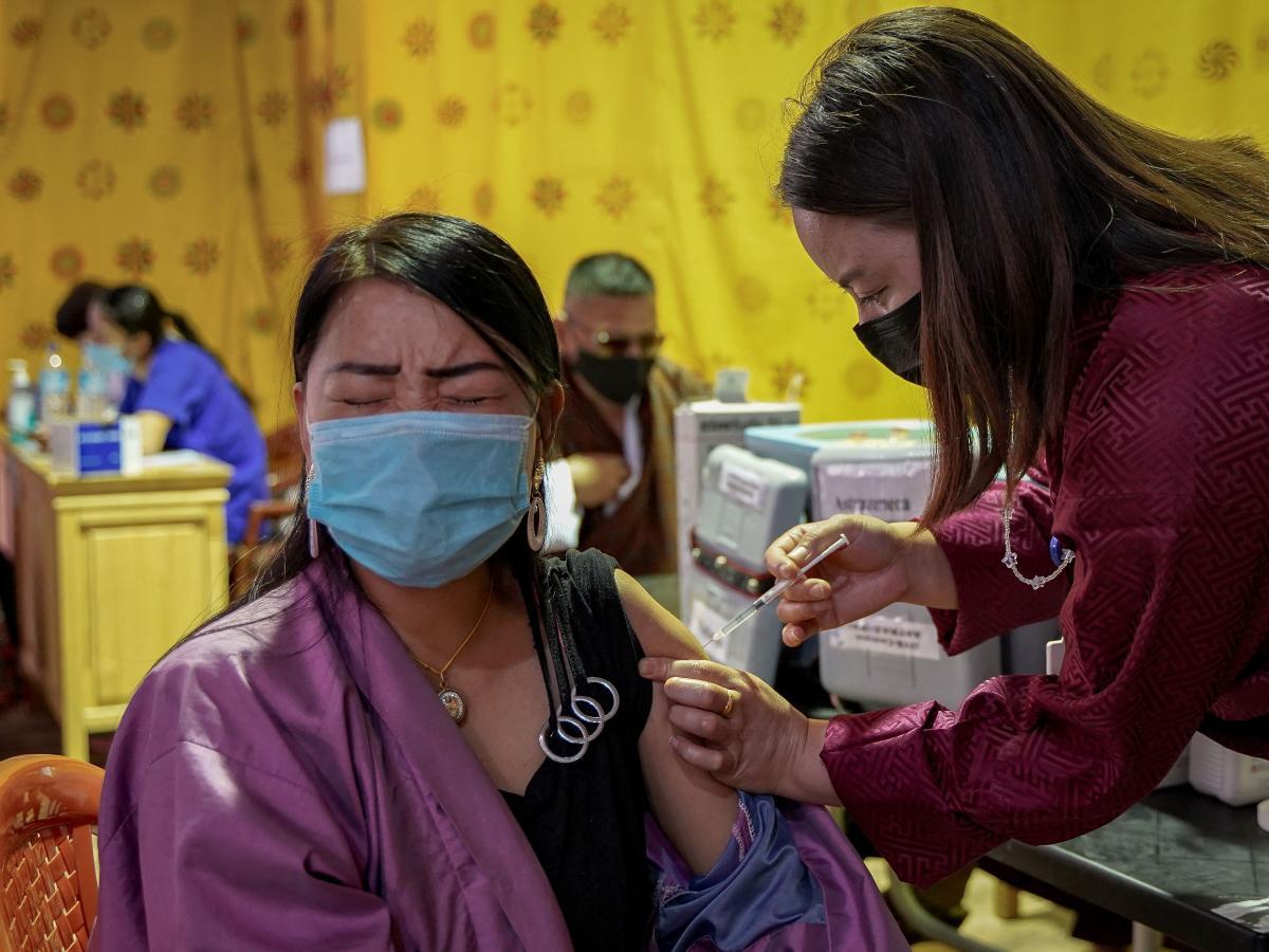 A health worker vaccinates a woman last week in Thimphu, Bhutan.