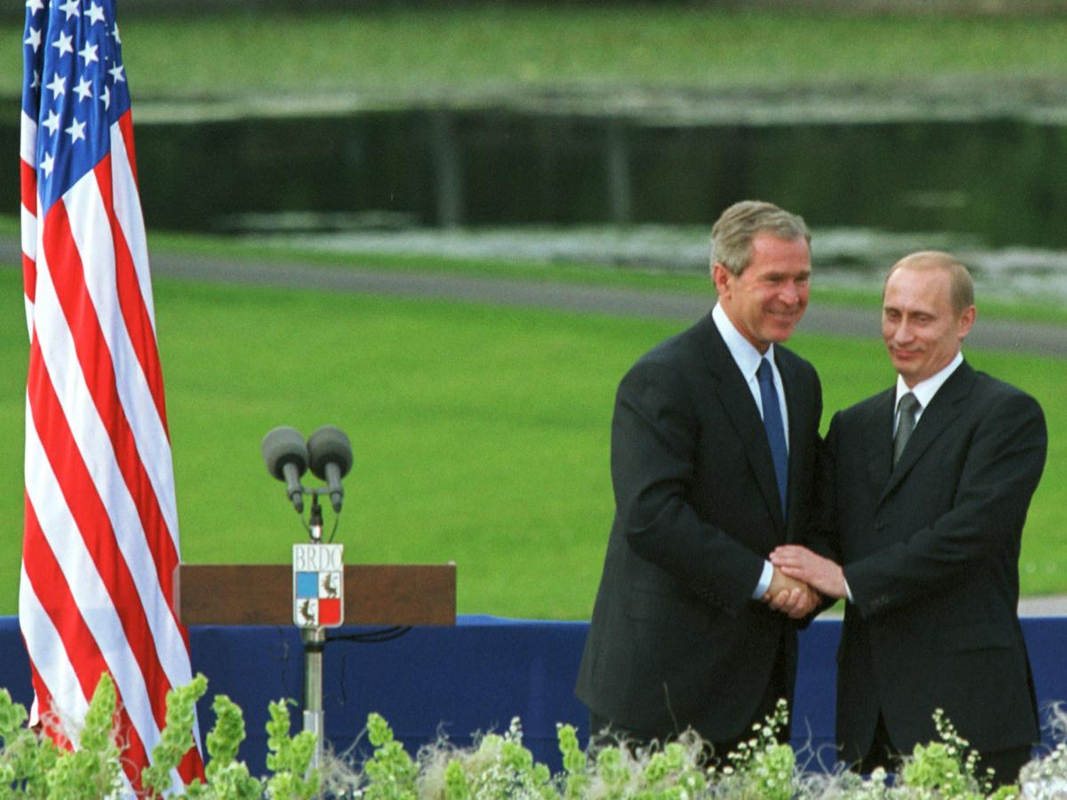 Former President George W. Bush and Russian President Vladimir Putin shake hands during their joint press conference June 16, 2001, in Ljubljana, Slovenia.
