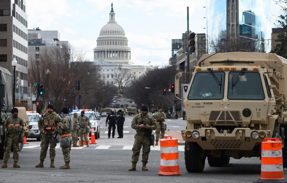 Members of the National Guard stand watch on an intersection in Washington, D.C., on Sunday.