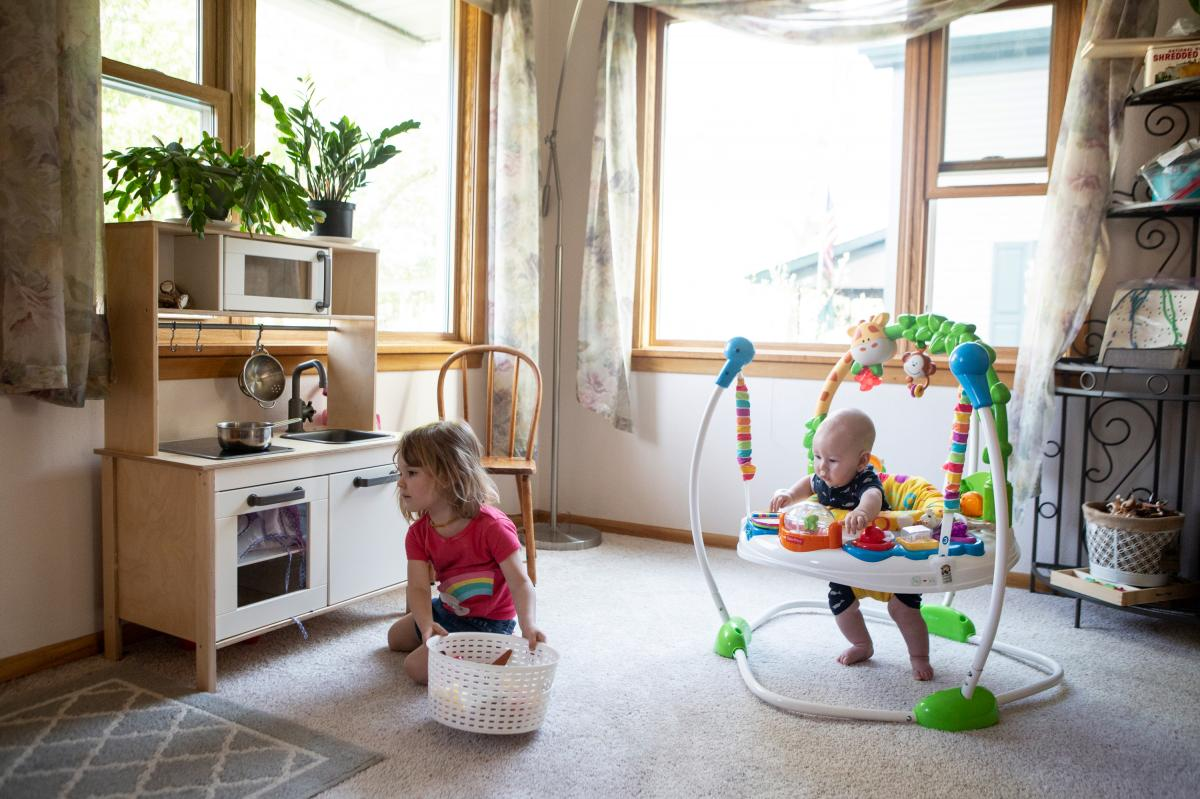 Karli-Rae Kerrschneider's children, Eleanor and Leviathan, play at their home in Baldwin, Wis.