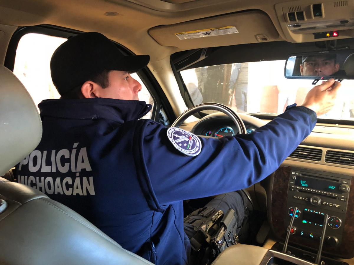 Tancitaro Assistant Police Chief José Antonio Flores Quezada patrols the town in an armored pickup. His family has been in the avocado business for generations and used to have to pay extortion money to organized crime gangs. Four years ago, he joined th