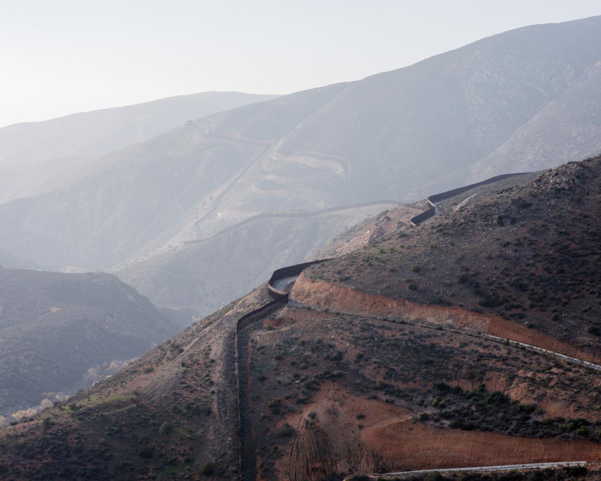A view of the U.S.-Mexico border fence as it heads west through the San Ysidro Mountains, seen from San Diego, Calif.