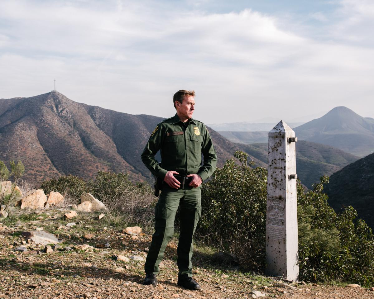 Chief Patrol Agent Rodney Scott stands near an old border monument at the base of the San Ysidro Mountains in southern San Diego County where current fencing ends.