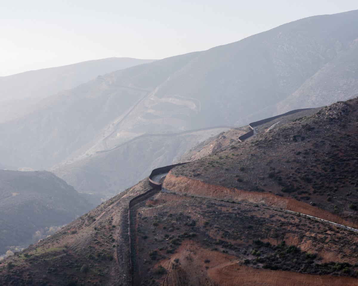 A view of the U.S.-Mexico border fence as it winds through the rugged San Ysidro Mountains southeast of San Diego. The administration is calling for 5 more miles of new barrier in this area.