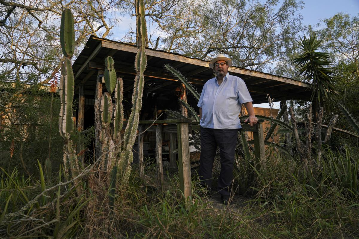 Tony Zavaleta stands at his historic ranch east of Brownsville, Texas, where he says a wildlife refuge next door has helped the deer population. He's even spotted a cougar.