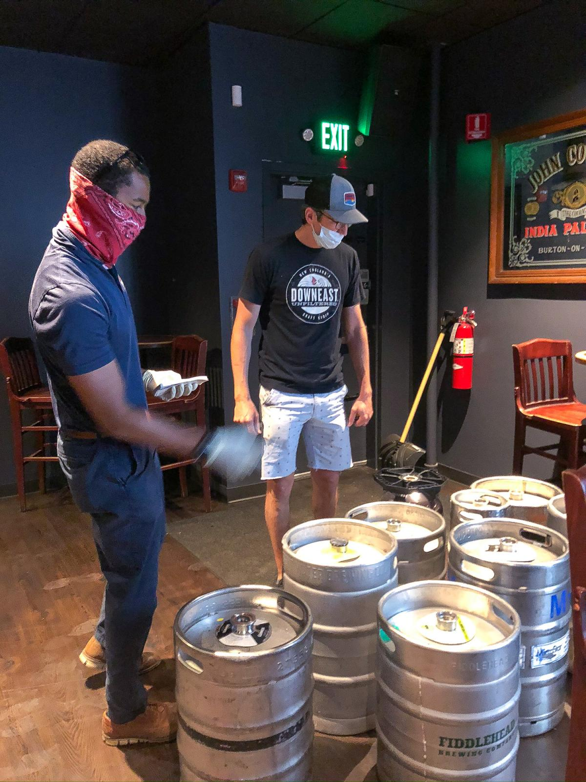 Vinny Gibson of Burke Distributing counts up kegs that Cornwall's is returning. The pub bought the beer in March, when it expected big crowds for Saint Patrick's Day, but the kegs have been gathering dust and the beer has gone flat since the pub closed be
