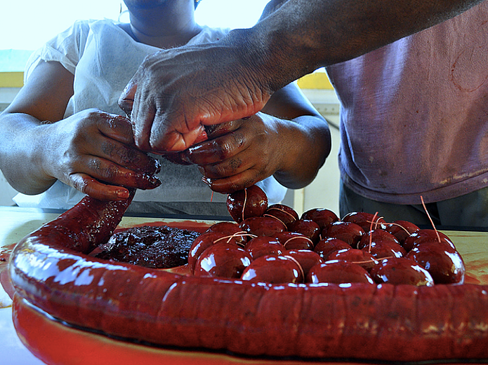 Making boudin is messy and bloody work and involves teamwork.